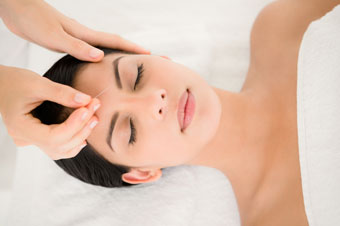 image of relaxed woman getting acupuncture